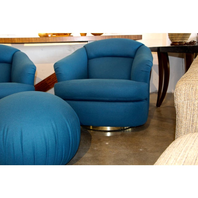 Directional set of two chairs and an ottoman in a new peacock blue wool fabric. Chairs swivel and lean back. On chrome or...
