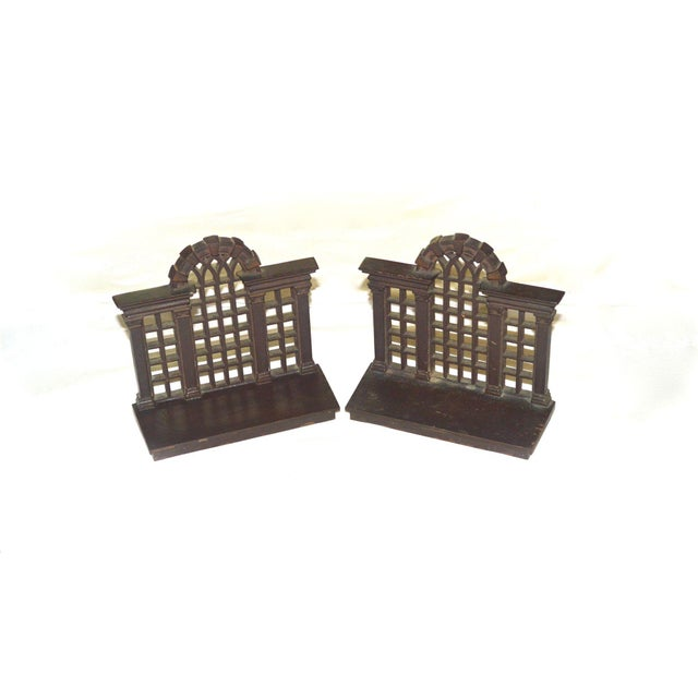 A pair of scarce 1920s cast iron bookends depicting a trellis or arched window. Each marked on the back with Bradley and...