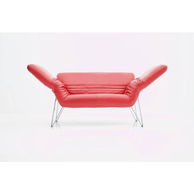Beautiful red two person leather sofa with individual adjust able arm and backrest. Very good condition. Worldwide shipping