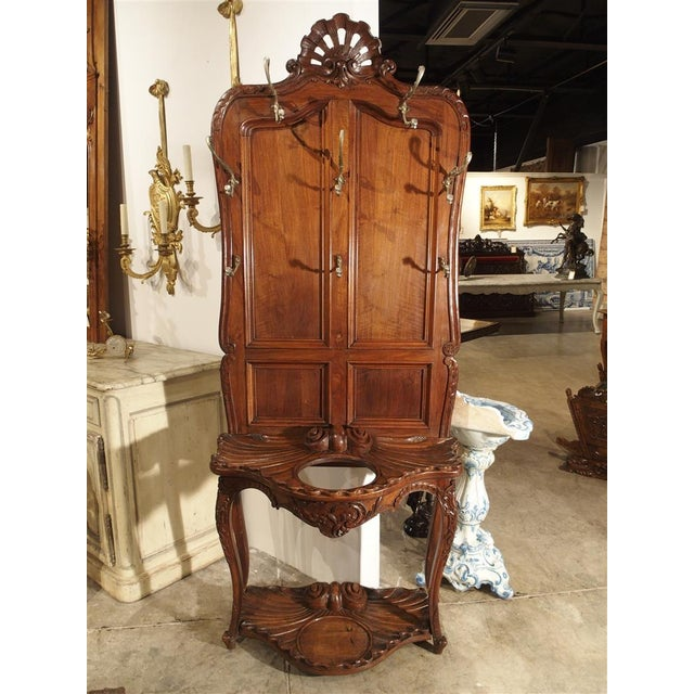 This versatile and unusual antique French hall tree and umbrella stand is in the Louis XV rocaille style. At the top...