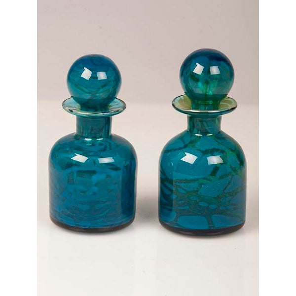 A pair of vintage hand blown Mdina glass decanters each with a hand blown spherical stopper from Malta circa 1970...