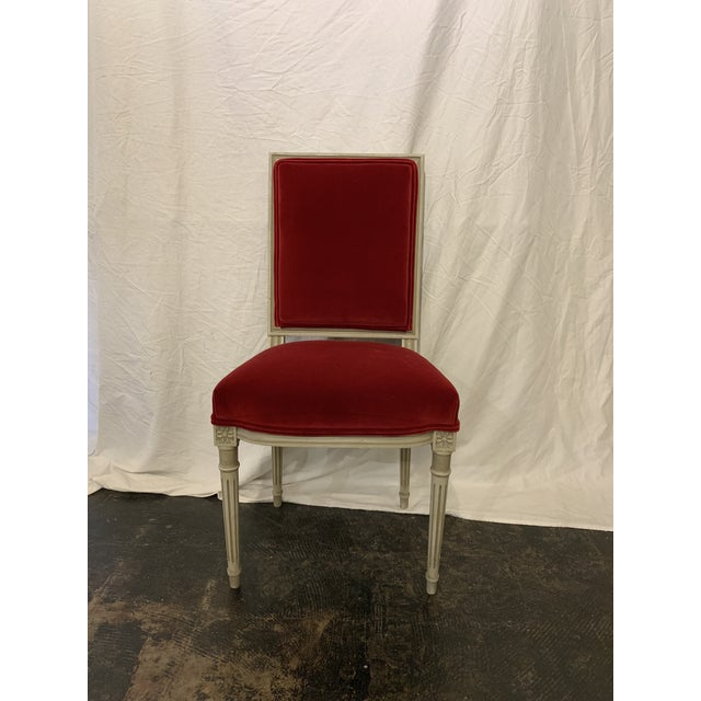 There is NOTHING like red velvet! These Louis XVI style gray painted chairs newly upholstered in red velvet and pair so...