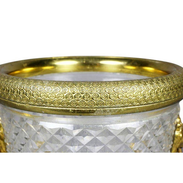 Engine turned gilt bronze rim and lions head side mounts, diamond cut cylindrical tapered body.