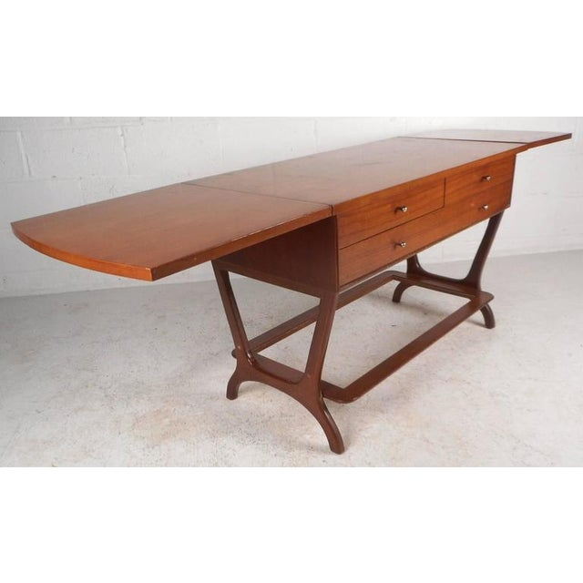This beautiful vintage modern piece has two leaves that extend the width of the top all the way to 76.5 inches. Versatile...