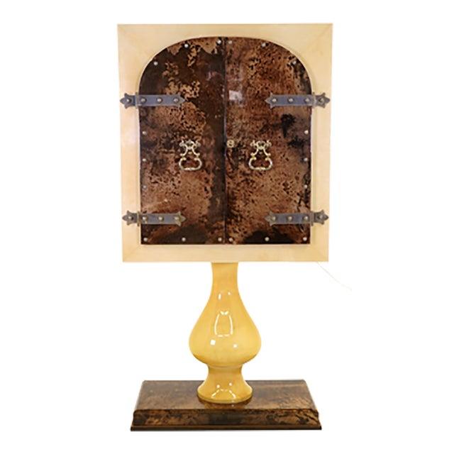 Aldo Tura floor standing bar cabinet. Locking doors with the original key. Mirrored interior with glass shelves. Interior...