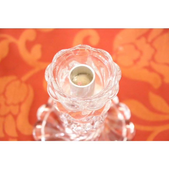 Baccarat crystal candlestick. Refined with their particular shape move. Signed Baccarat France.