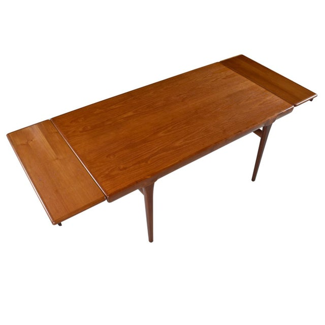 Wood Large Scandinavian Modern Teak Draw Leaf Expanding Dining Table, circa 1960's For Sale - Image 7 of 7