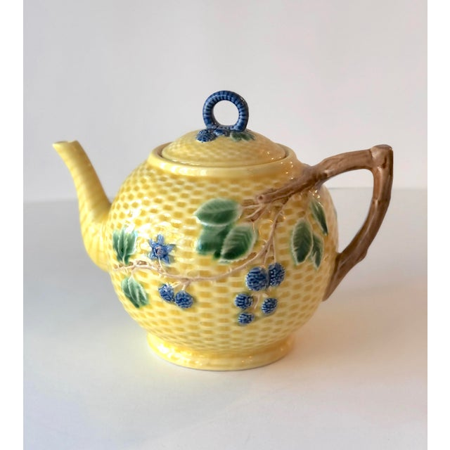 Tiffany & Co. Majolica blackberries pattern made in Portugal. Set comes with lidded teapot, creamer, lidded sugar bowl and...