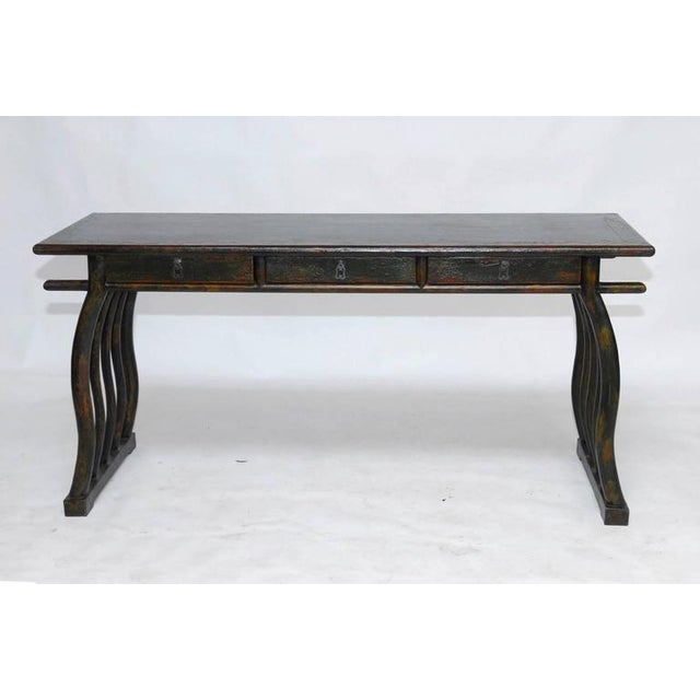 Rare and unusual Chinese writing table or scroll viewing table fronted by three drawers, supported by five serpentine legs...