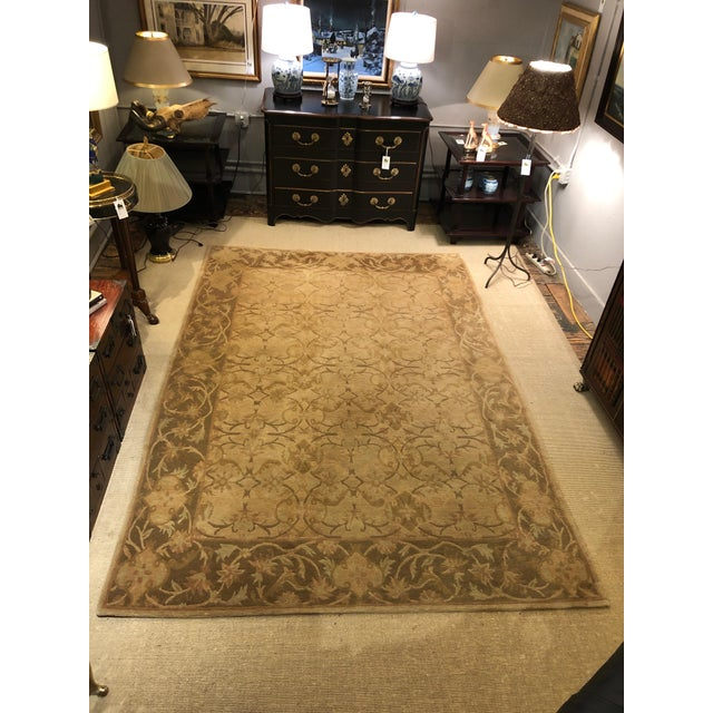 A beautiful silk Tibetan area rug in shades of camel, cream and brown with wonderful pattern.