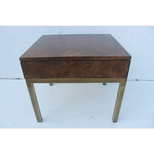 Mid-century Modern 1970s end table featuring burlwood and lacquered brass metal base. Includes one drawer. By Tomlinson...