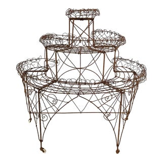 Early 20th Century Victorian Three Tiered Iron Wire Plant Stand With Distressed Finish For Sale