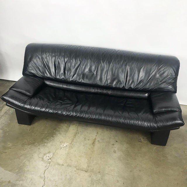 Italian black leather sofa by Nicoletti Salotti. This comfortable modern sofa has been freshly cleaned and the leather has...