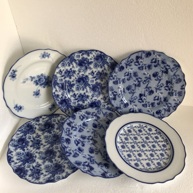 Beautiful set of six blue and white rose pattern plates or dishes with rippled sides, blue edges and assorted rose...