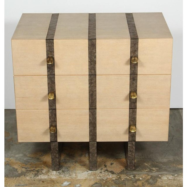 Paul Marra Three Drawer Banded Chest in bleached douglas fir and inset embossed iron band, mitered edges, brass pulls. By...