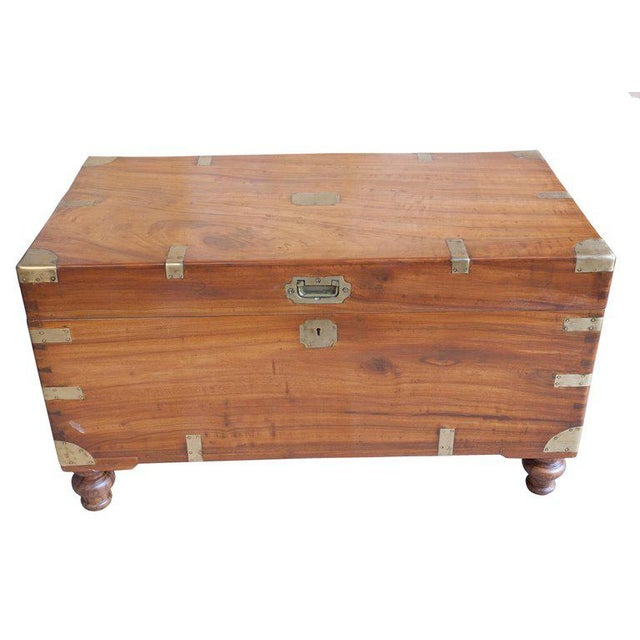 Classic British campaign camphor wood sea chest. Brass straps and handles, recessed brass pull and escutcheon with working...