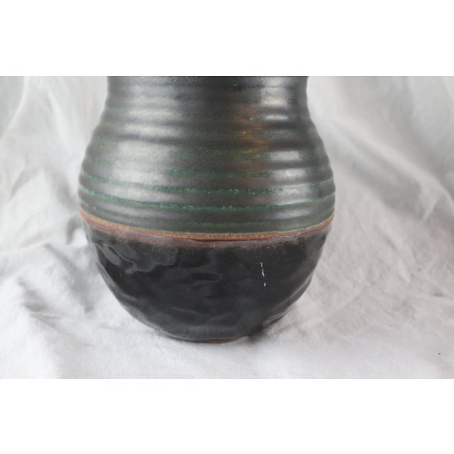 Vintage cachepot with a variety of textures. Ringed green top half with glazed smooth bottom half separated by a seeping...