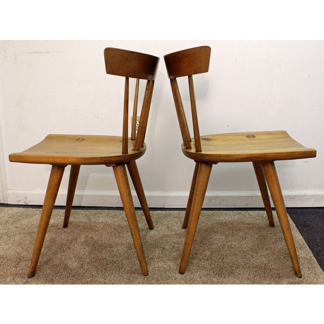 Offered is a Pair of Mid-Century Danish Modern Paul McCobb Spindle Back Side Dining Chairs. The set has great lines and...