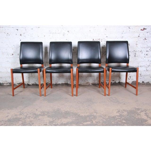 A gorgeous set of four mid-century Danish Modern dining chairs designed by Torbjorn Afdal for Nesjestranda Møbelfabrik of...