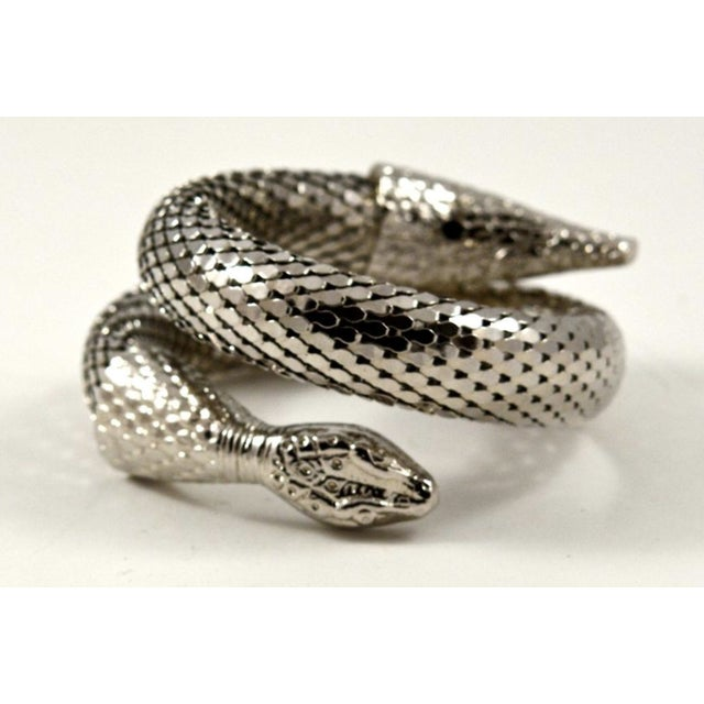 Like new, iconic mesh two-coil snake cuff by Whiting & Davis. Shiny silver tone metal. Adjustable size for up to a medium-...