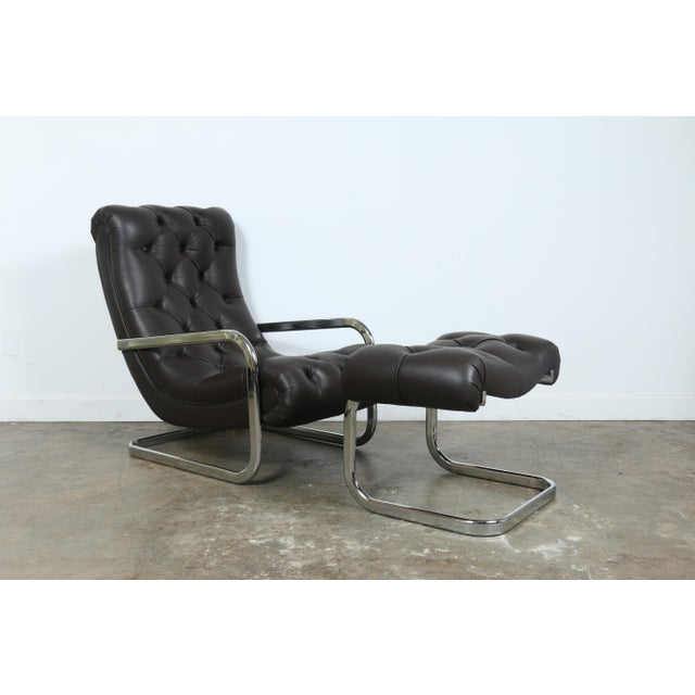 Italian Leather Chair and Ottoman Nice vintage set. Has been reupholstered. Real leather. No rips or damages. Chrome base...