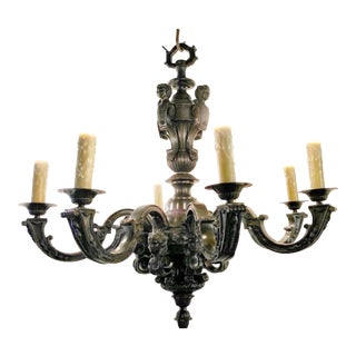 Louis XIV Style Cast and Patinated Bronze Eight Light Chandelier For Sale
