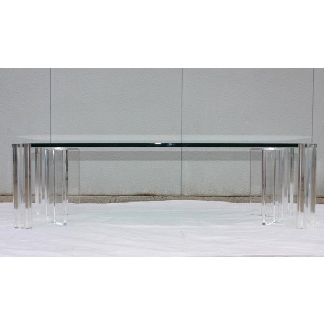 Stunning 1970s large Mid-Century Modern Lucite and glass coffee table. With 3/4'' glass top.
