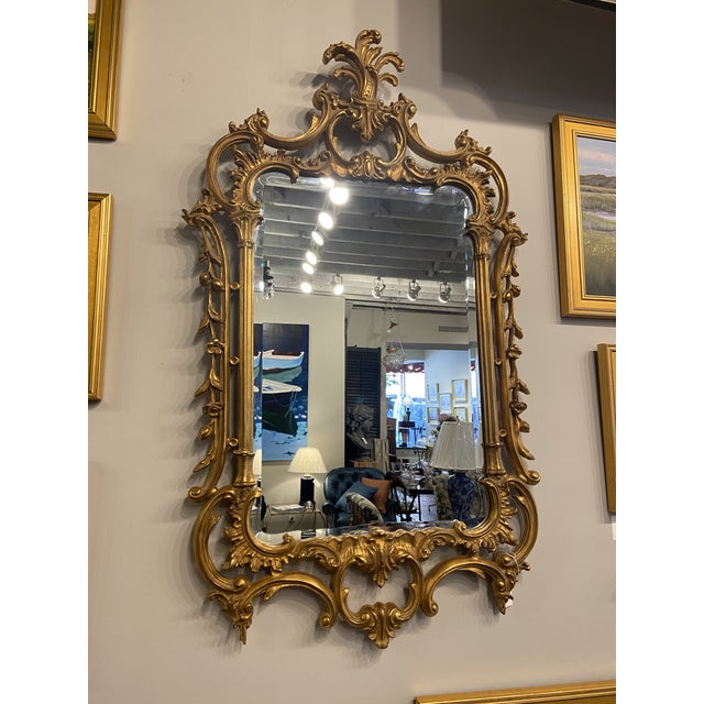 This is a gorgeous gold accent mirror. It is composition wood, not solid wood. You couldn't tell the difference based on...