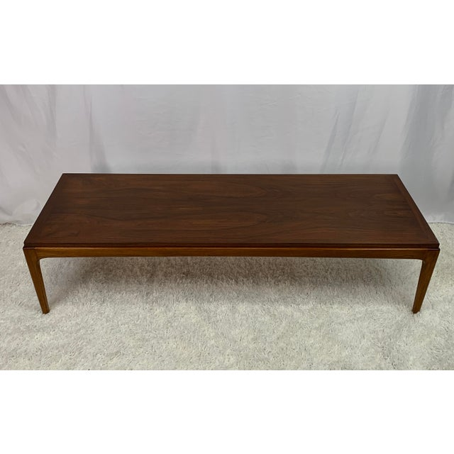 Paul McCobb inspired minimalist lines and tapered legs make this long and low rectangular coffee table from Lane's iconic...