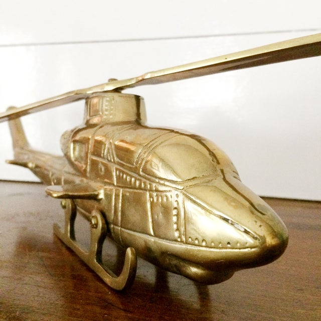 This is a rare, vintage 1960s brass helicopter. It has the original spinning propeller. Perfect as a paperweight or just...