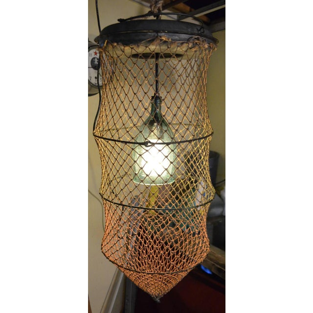 Pendant Light From Seltzer Bottle Inside Fish Trap - Image 2 of 10