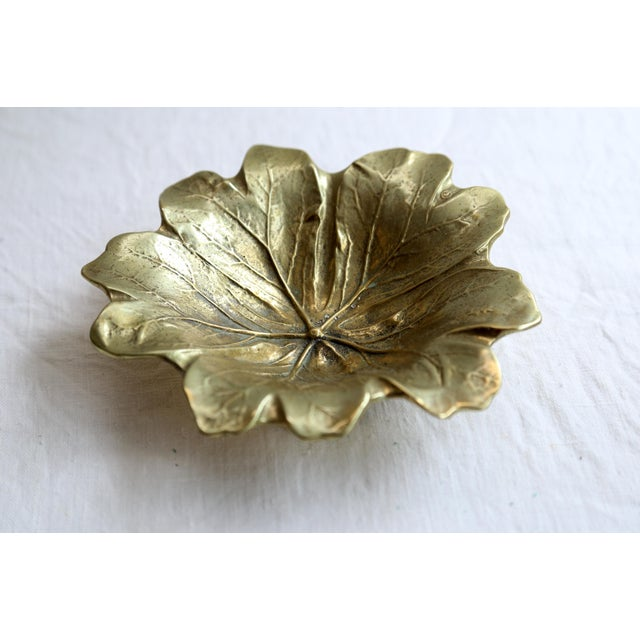 Vintage heavy brass round leaf dish. Copyright 1949 by Virginia Metalcrafters.