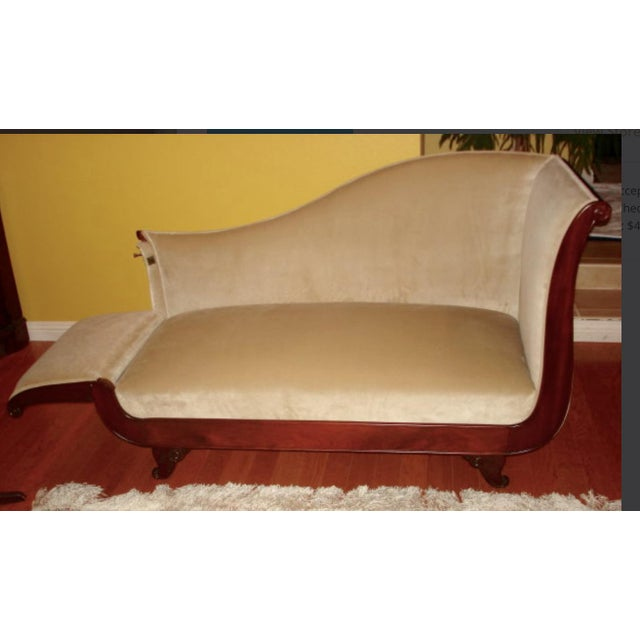 Beautiful settee with one side that releases to make it into a chaise lounge or day bed.