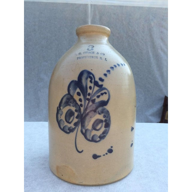 Stoneware jug with handle Signed E. G. Chase & Co. Providence. Rhode Island Wide mouth opening three inches in diameter...