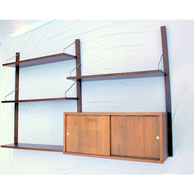 A beautiful teak Cado Royal System wall unit designed by Poul Cadovius. This is a two bay unit consisting of 3 wall...