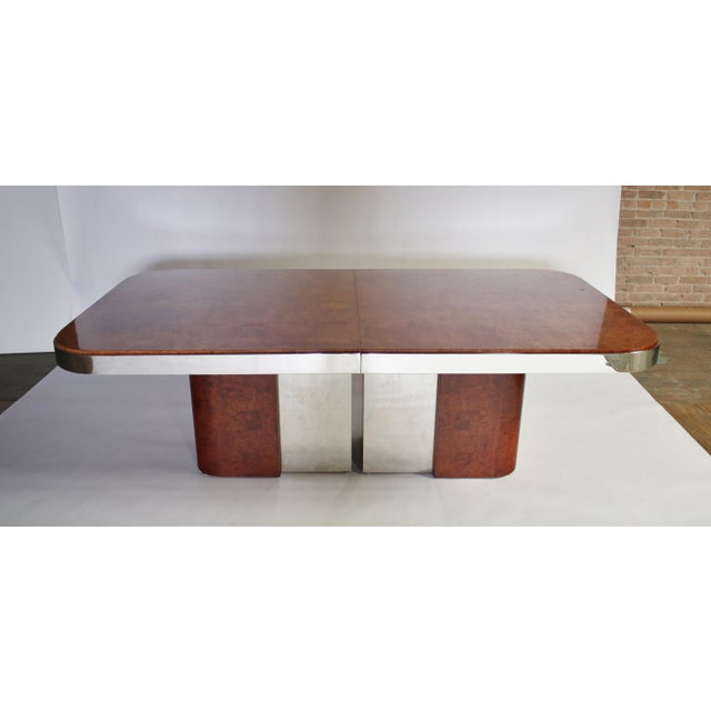 Unique and possibly custom 1970's dining table in a gorgeous burl wood with steel racetrack apron in the style of Paul...