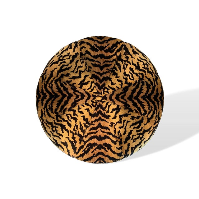 Large 41-inch circular ottoman in Italian designer ultra high-end silky tiger skin woven heavy cut and uncut chenille; the...