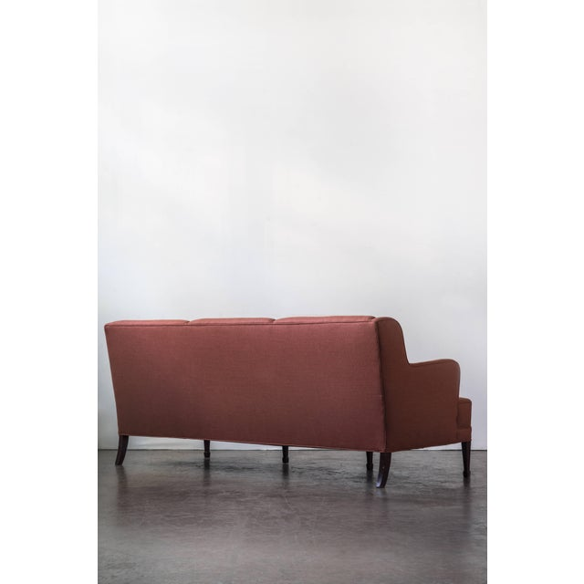 A newly upholstered classic three-seat sofa by Frits Henningsen with mahogany legs. Re-Upholstered by ASH NYC in a...