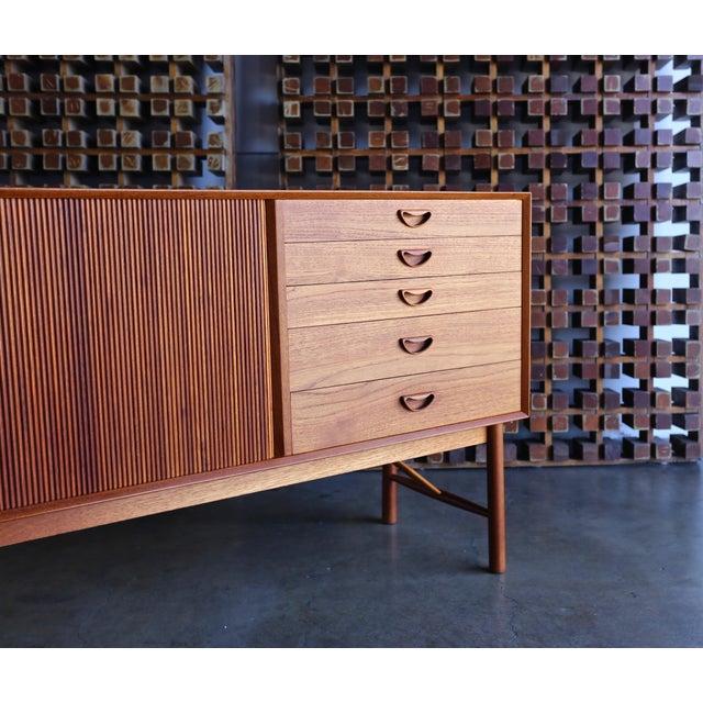 Teak Tambour Door Cabinet by Peter Hvidt & Orla Mølgaard Nielsen. This piece is in very good original condition.