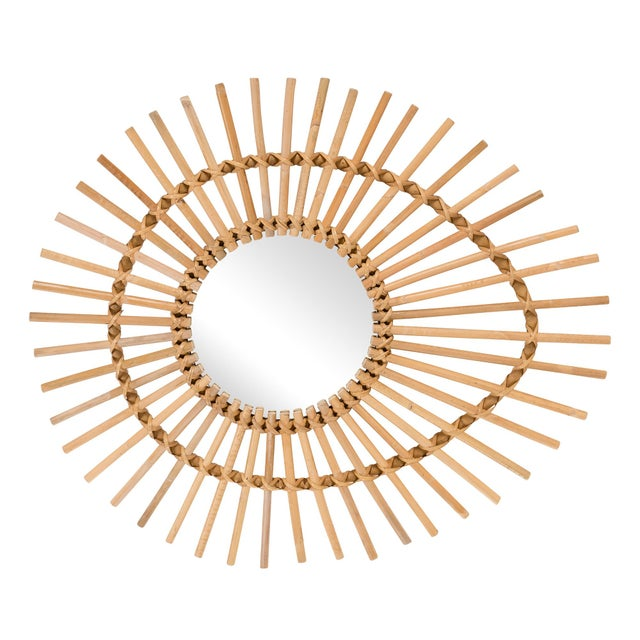 Natural rattan and leather wrapped flower setting sun design mirror with art deco flare.