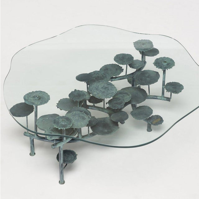 Silas Seandel sculptural bronze coffee table with glass top. Table base has a nice patina.