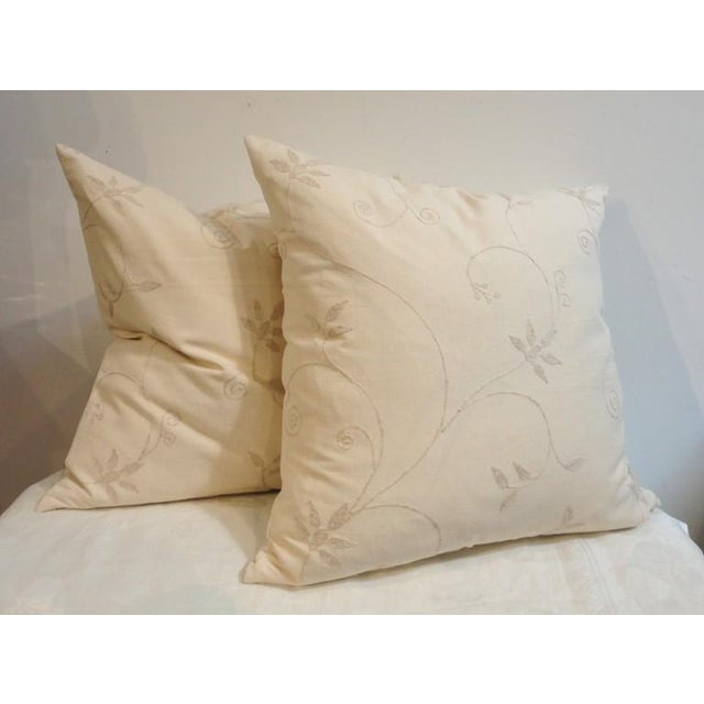 Fantastic cream colored crewel work pillows with cream colored linen backing. The inserts are down and feather fill, with...