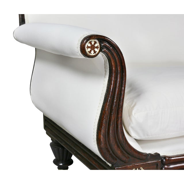 Antique settee with scrolled upholstered back and reeded out swept arms all with brass inlay, reeded seat rail,...