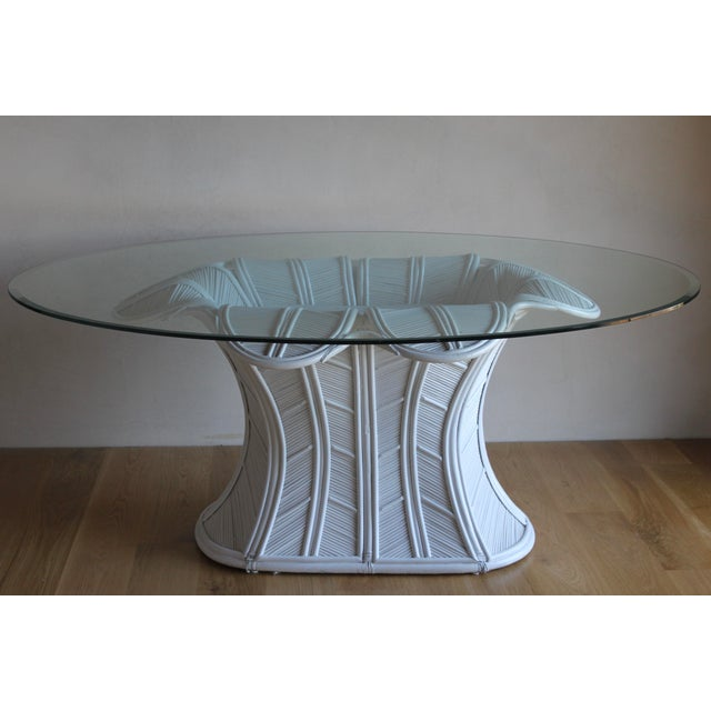 Stunning, sculptural pencil reed dining table lends a fabulous vibe to any dining room! A little tropical, a little Post...