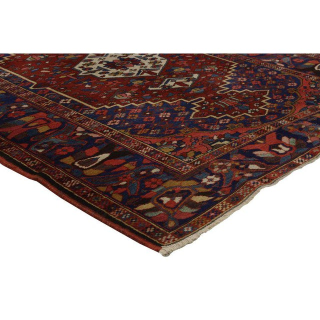 Featuring highly desirable colors and a traditional modern style, this antique Bakhtiari Persian rug embodies a harmonious...
