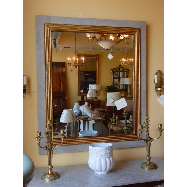 Directoire' gilt mirror on painted wood background. Original glass.