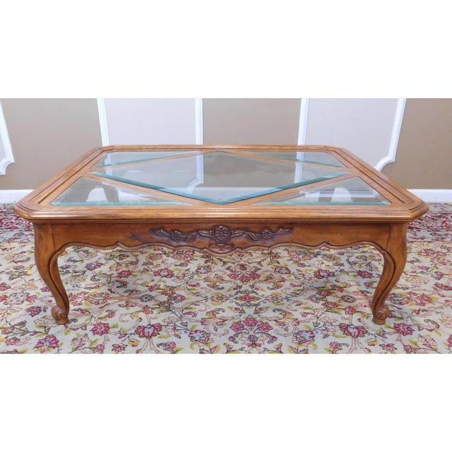 This is a very clean Drexel Heritage French Country Cabernet Collection glass inserted coffee table, circa 1990s model...