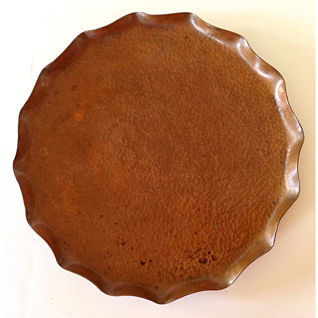 Hand wrought copper tray from the isle of Tasmania. Raised pie crust edge with maker's mark on the bottom of the piece....