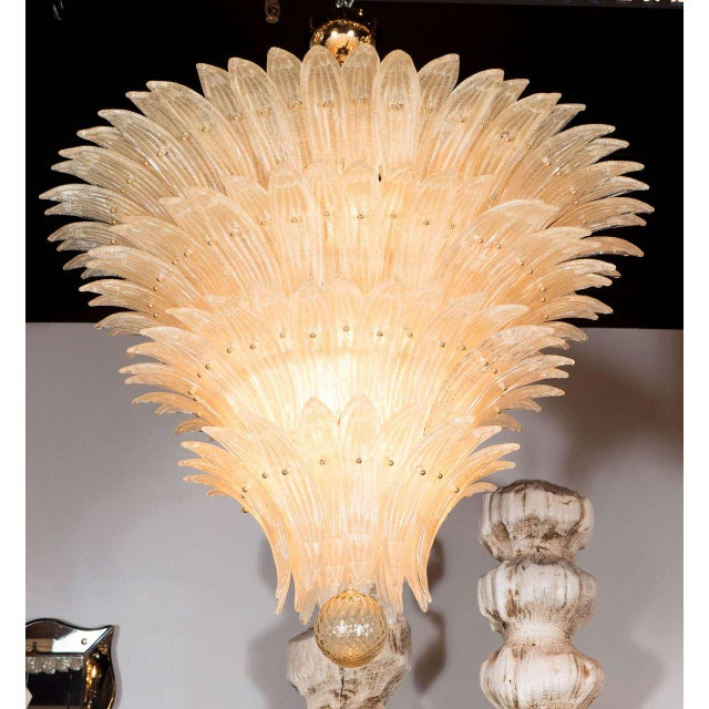 This exquisite Palma chandelier consists of five tiers of individually handblown Murano glass stylized palm fronds in an...