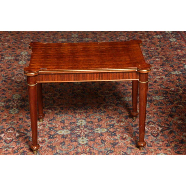 Jules Leleu (1883-1961). Rosewood marquetry, with gilded bronze accents side table. Signed, numbered and dated 1953....